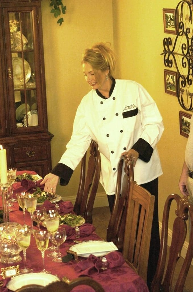 personal chef serving dinner party