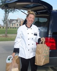 personal chef carrying groceries for client